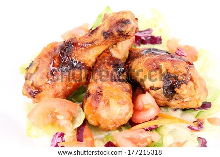 Fried chicken legs with side salad