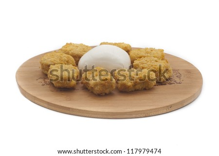 fried chicken nuggets and mozzarella cheese on wooden desk - stock photo