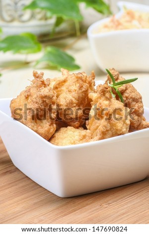 Fried chicken nuggets in white bowl