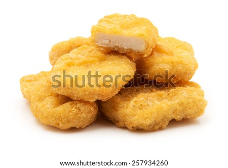 Fried chicken nuggets isolated on white - stock photo