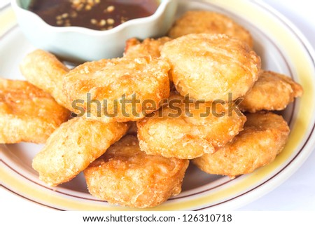 Fried chicken nuggets with sweet chilli sauce - stock photo