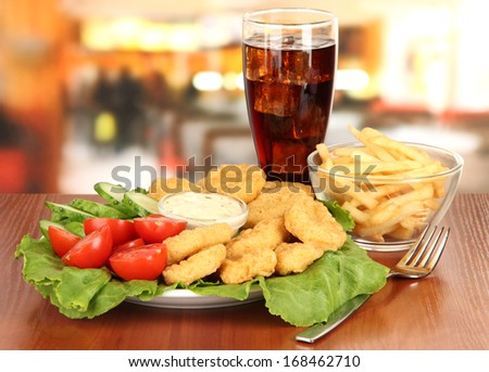Fried chicken nuggets with vegetables,cola,french fries and sauce isolated on white - stock photo