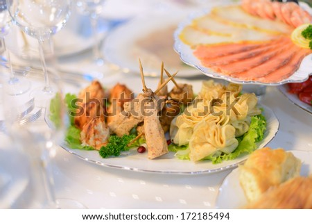 fried chicken on sticks and pancakes - stock photo