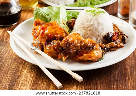 Fried chicken pieces in batter with sweet and sour sauce - stock photo