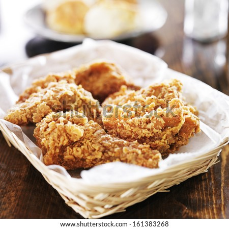 fried chicken pile in a basket on table - stock photo