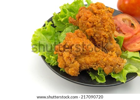 Fried chicken slices on lettuce.