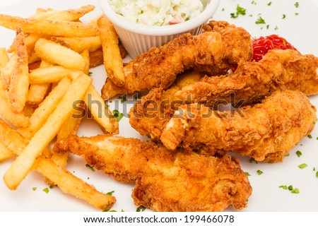Fried chicken tenders served with french fries and cole slaw. - stock photo