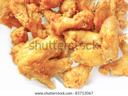 Fried chicken thailand on white paper isolated - stock photo