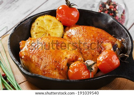 fried chicken thigh in a pan - stock photo