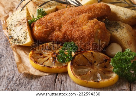 Fried chicken wings dipped in batter with vegetables close-up. rustic style. horizontal  - stock photo