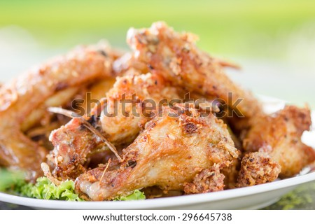 Fried chicken wings in plate - stock photo