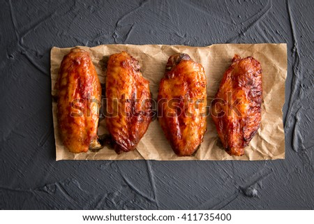 Fried chicken wings on a dark gray background