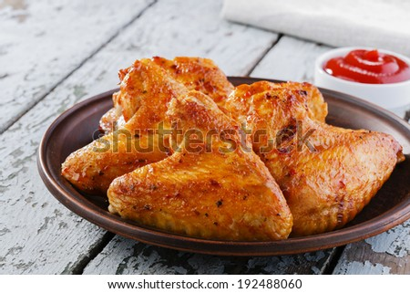 fried chicken wings on a plate - stock photo