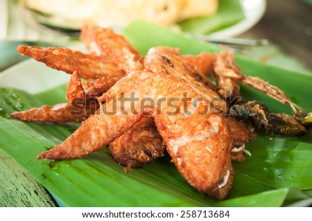 Fried chicken wings with thai herbs - stock photo