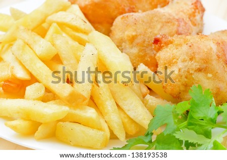 Fried chicken with french fries, close up view
