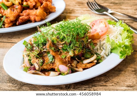Fried chicken with hot and spicy sauce in Thai halal restaurant - stock photo