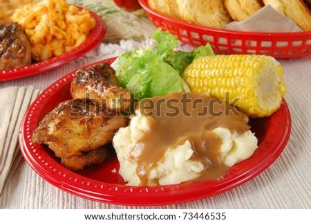 Fried chicken with mashed potato and gravy - stock photo