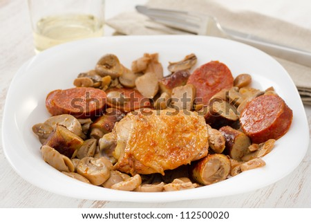 fried chicken with mushrooms and sausages
