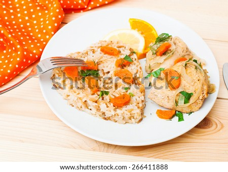 fried chicken with rice in white plate on wooden table - stock photo