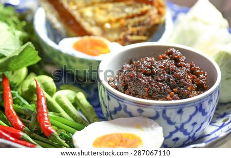Fried chili paste, eaten with vegetables and fried fish, (thai language  nam prik pao) - stock photo