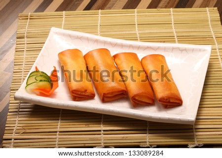 Fried Chinese Traditional Spring rolls food in white square dish - stock photo