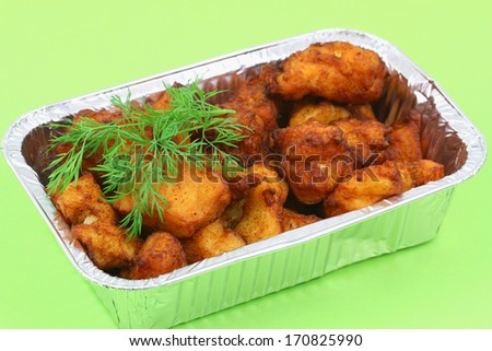 Fried cod pieces in take away tray  - stock photo
