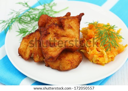 Fried cod pieces with vegetables