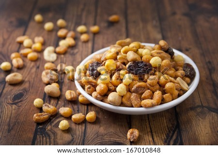 fried corn in white plate over wood background - stock photo