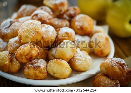 fried cottage cheese balls with slices of quince in - stock photo