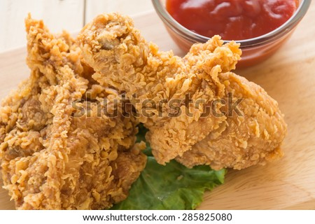 fried crispy chicken on wood - stock photo
