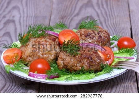 Fried cutlets  and vegetable salad