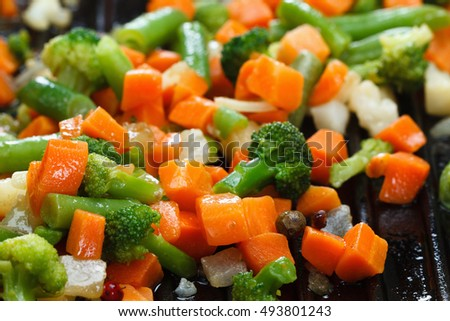 Fried delicious sliced vegetables on grill pan