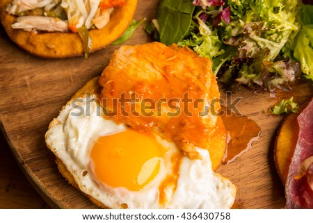 Fried egg and meat dish - stock photo