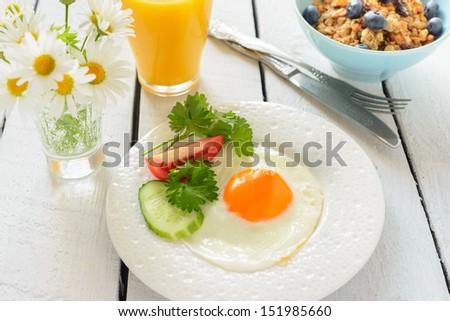 Fried egg and muesli  for breakfast - stock photo