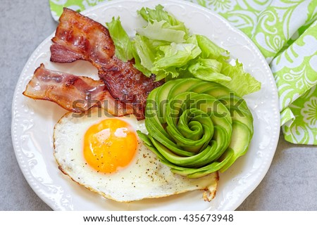 Fried Egg, Bacon and Avocado Rose. Low carb high fat breakfast - stock photo
