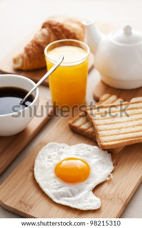 Fried egg for breakfast close up shoot - stock photo