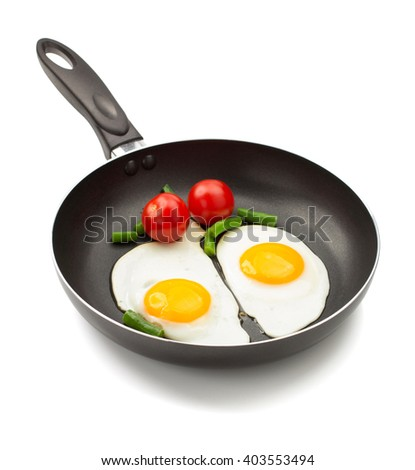 fried egg in frying pan isolated on white background - stock photo