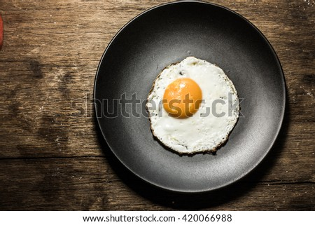 Fried egg on a cast iron pan  - stock photo