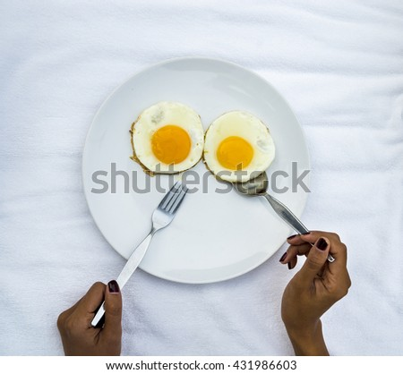 Fried egg on white dish