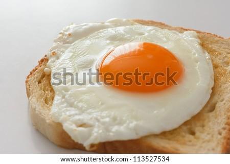 Fried egg on white toast - stock photo