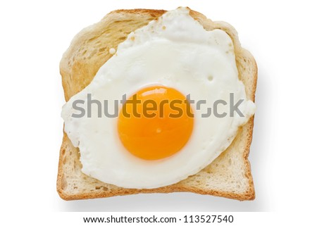 Fried egg on white toast from above. - stock photo