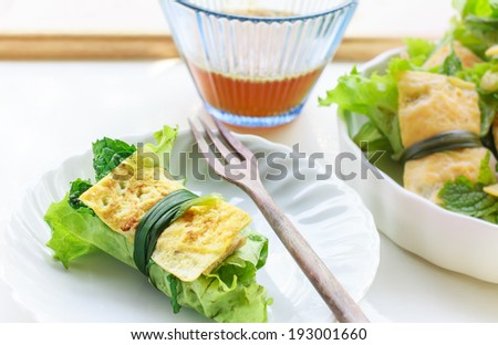 fried egg rolled with fresh vegetable - cuon hanh - Vietnamese food