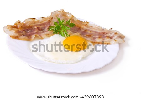 fried egg with bacon isolated - stock photo
