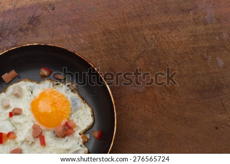 Fried Egg with pan and other ingredients, tomato, hot dog, isola - stock photo