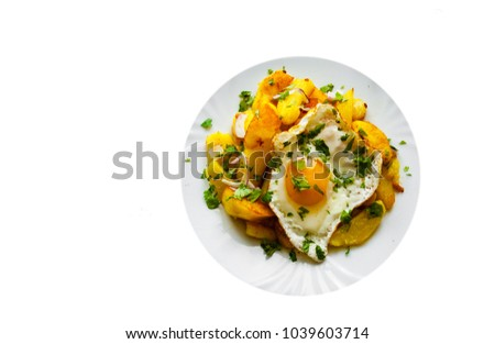 fried egg with potato in a plate isolated on white background. with copy space. top view
