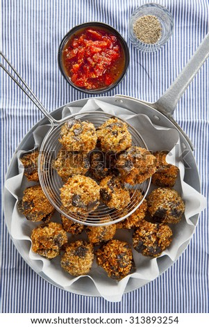 fried eggplant appetizer. vegetarian aubergine balls. with tomato sauce and spices. vegan cuisine - stock photo