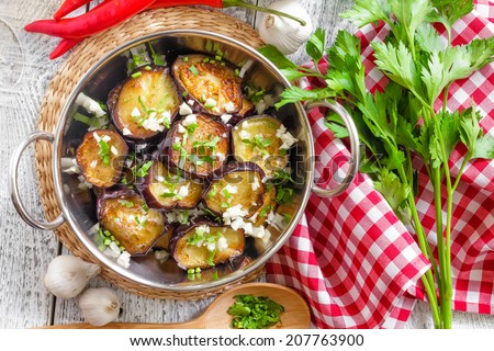 Fried eggplant with garlic - stock photo