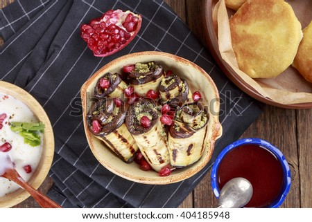 Fried Eggplant with Walnut Sauce. Badridzhani. Georgian cuisine. Top view. - stock photo