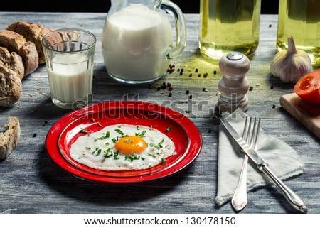 Fried eggs and bread for breakfast - stock photo