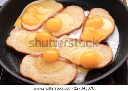 fried eggs and fried bread as part morning food - stock photo